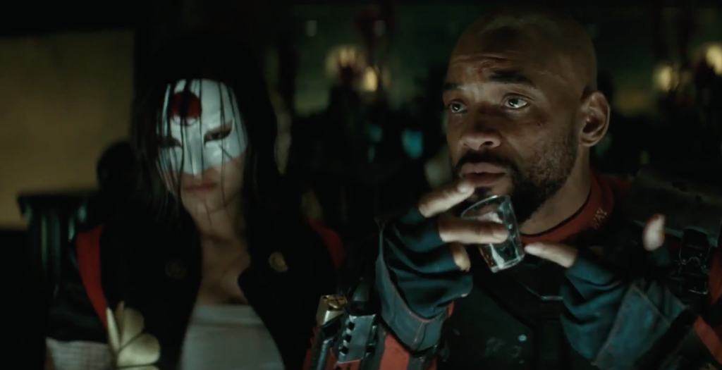 Will Smith, Deadshot with a shot glass in hand in Suicide Squad