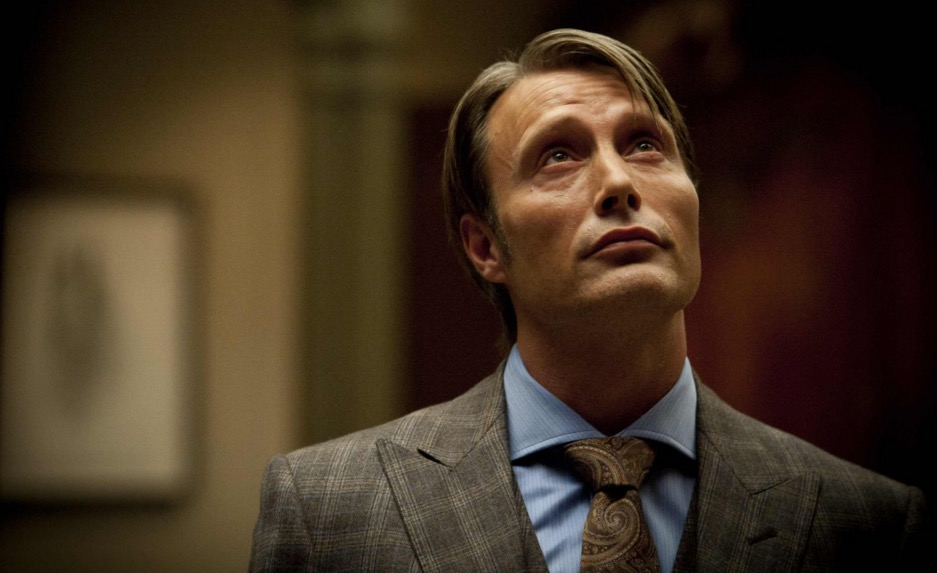 Hannibal wearing a plaid suit, looking up
