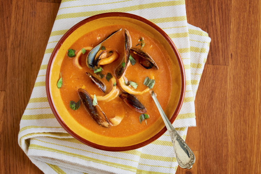 bowl of seafood soup with mussels
