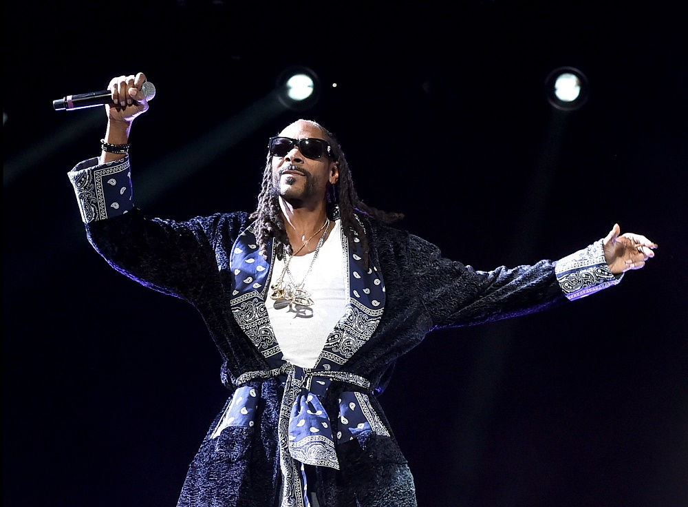 Snoop Dogg is on stage in a robe.