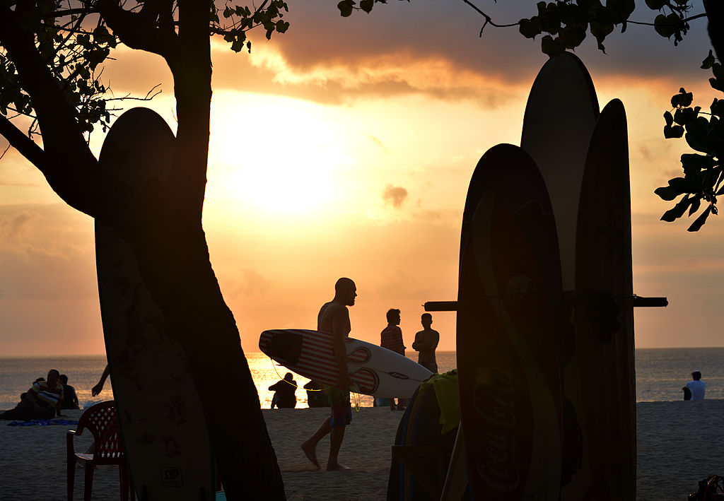 surfers on the beach in Bali