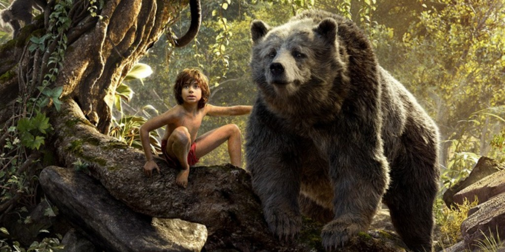Mowgli and Baloo standing on a tree branch in the jungle