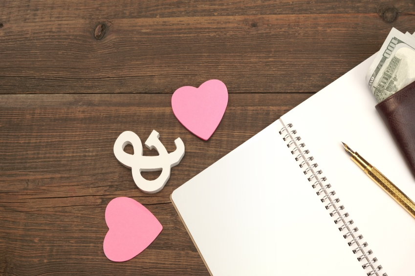 love hearts with pen, a copy and a wallet
