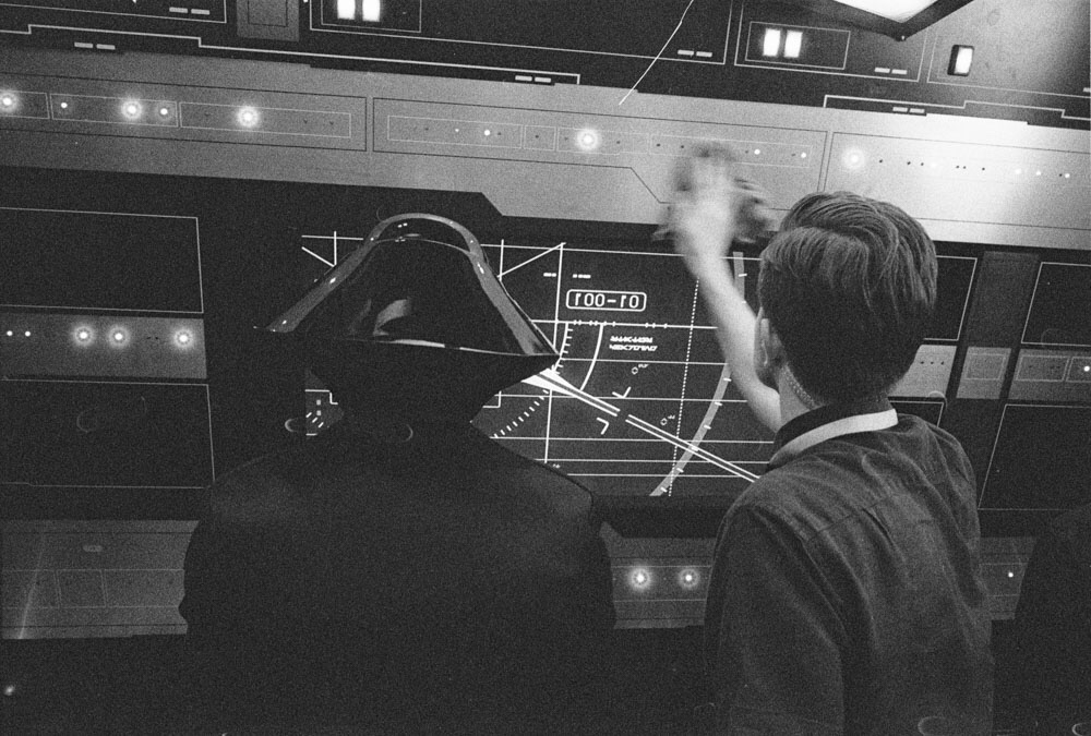 Rian Johnson wiping down a control panel