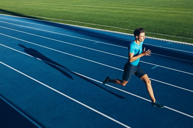 male athlete running on a race track