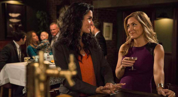 Angie Harmon and Sasha Alexander chat at a restaurant in a scene from Rizzoli and Isles
