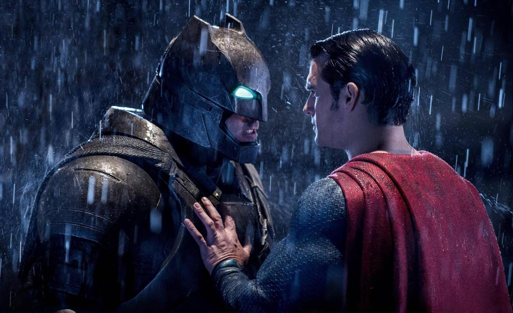 Batman gets in a heated exchange with Superman while standing in the rain