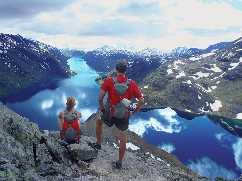 people hiking Besseggen ridge overlooking the lakes in Norway