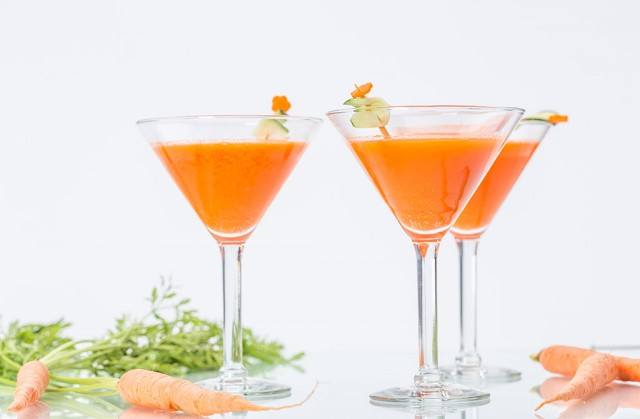 carrotini cocktail from Drizly in martini glasses