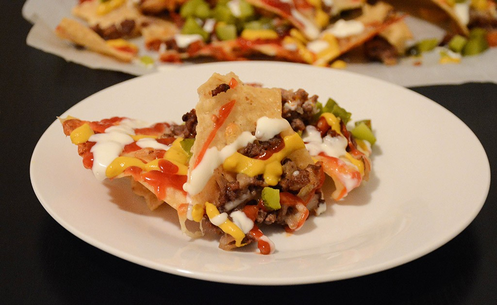 close-up of a serving of cheeseburger nachos on a plate