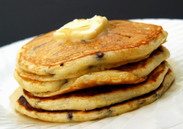 butter on chocolate chip pancakes