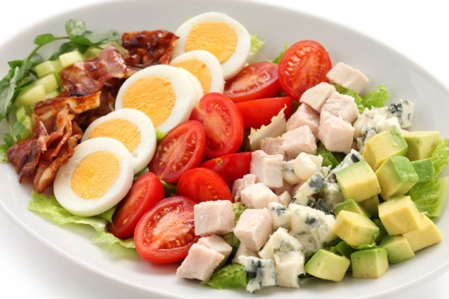 closeup of cobb salad in white plate