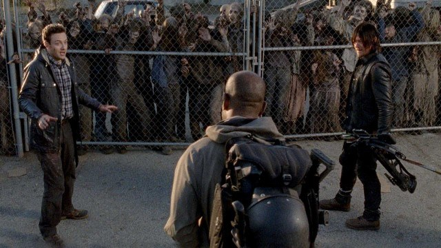Aaron (Ross Marquand), Morgan (Lennie James) and Daryl (Norman Reedus) stand before a hoard of walkers in the 'Walking Dead' fifth season finale, 'Conquer.'