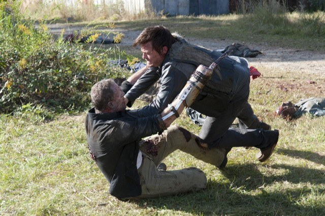 Daryl (Norman Reedus) wrestles his brother Merle (Michael Rooker) to the ground in a scene from 'The Walking Dead' episode 'This Sorrowful Life.'