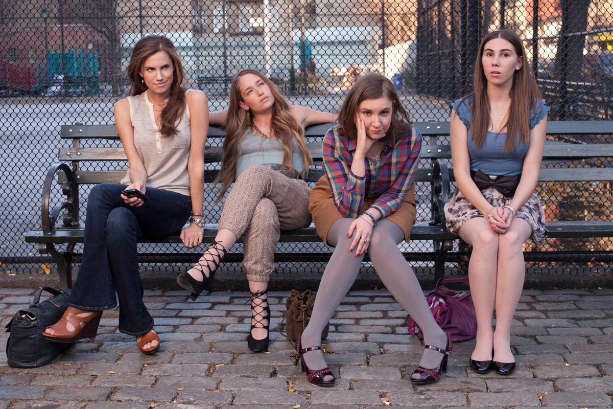 Marnie, Jessa, Hannah, and Shoshanna sit on a bench in NYC