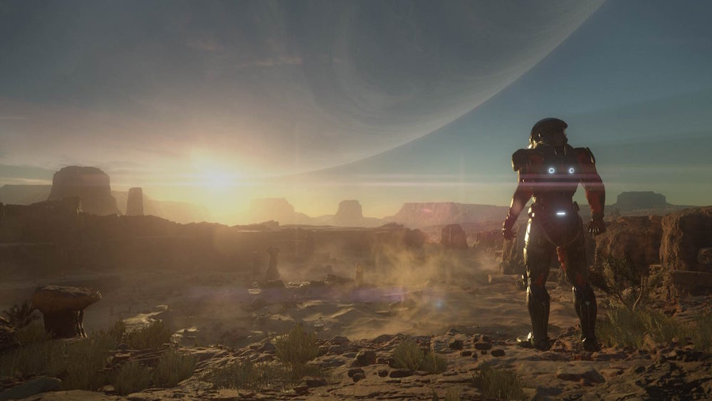 A space marine sees the sunrise on an alien planet.