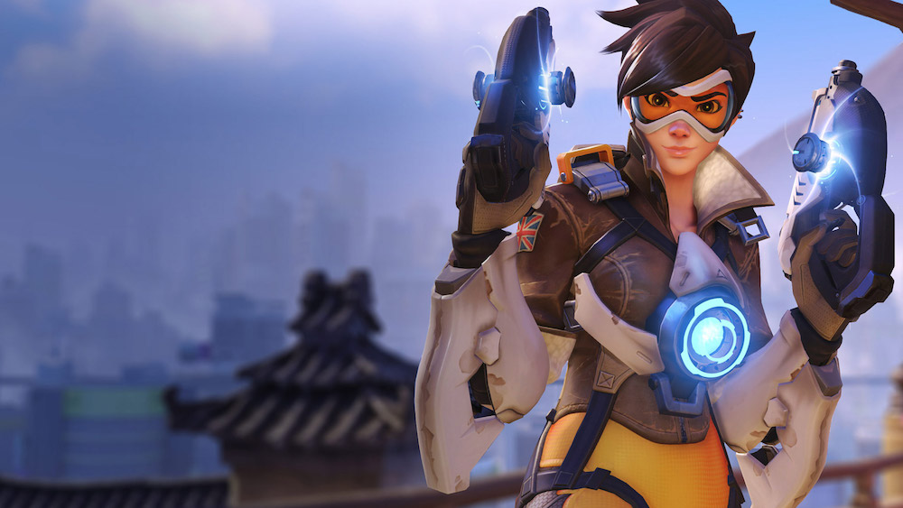 "Tracer from ""Overwatch"" stands with two pistols raised."