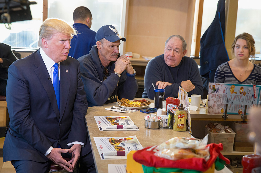 Donald Trump sitting with a group