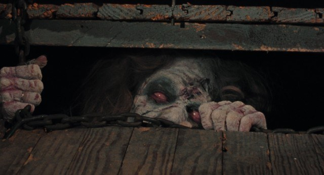 Cheryl (Ellen Sandweiss) tries to escape from the cellar in a scene from Sam Raimi's cult horror classic 'The Evil Dead.'