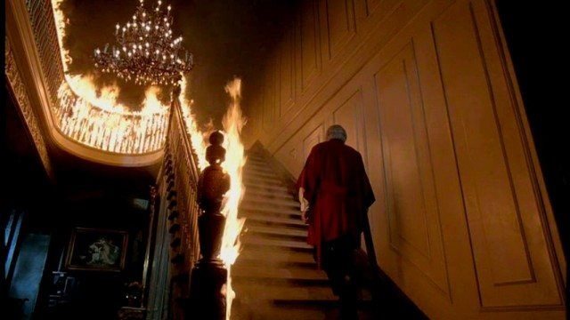John Russell (George C. Scott) ascends a fiery staircase in a scene from the 1980 horror classic 'The Changeling.'