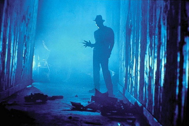 Freddy Krueger (Robert Englund) appears in a dark hallway in a scene from Wes Craven's 'A Nightmare on Elm Street'