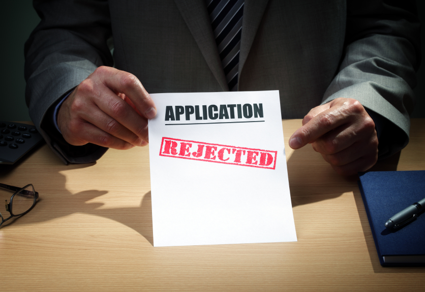 "paper that says ""application rejected,"" telling someone they weren't hired"