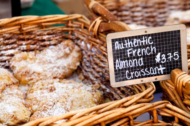 French almond croissant at a market in a wicker basket