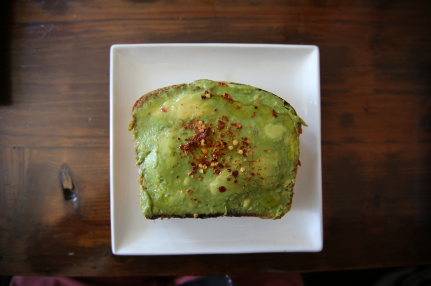 overhead image of avocado toast sprinkled with chile flakes