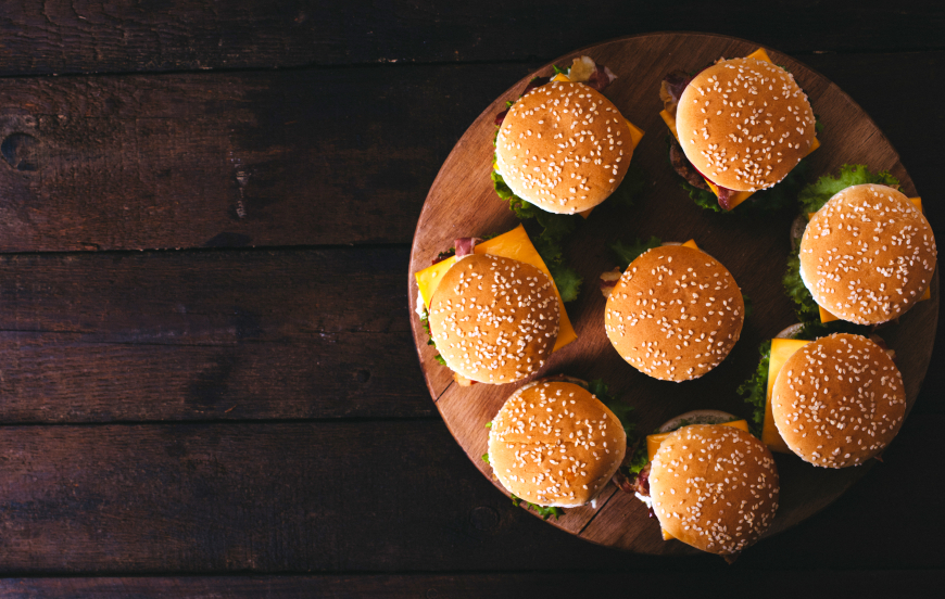 Burgers on a wooden tray