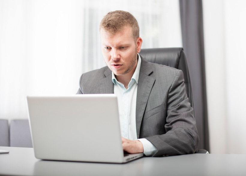 Businessman looking at his laptop