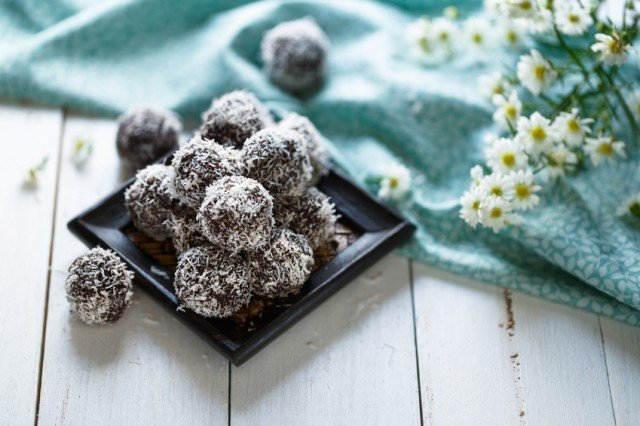 healthy chocolate and coconut truffles rolled in flaked coconut