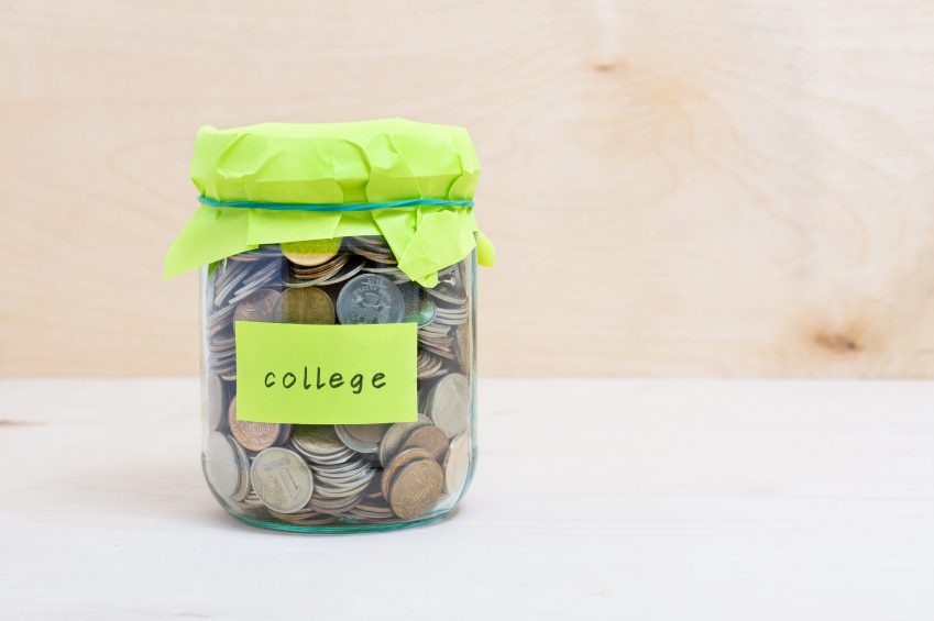 glass jar full of coins to pay for college costs