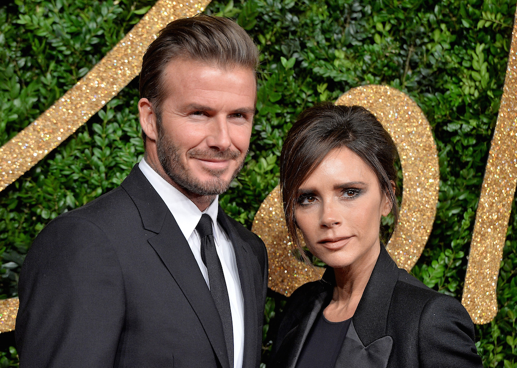 David Beckham and Victoria Beckham pose in black