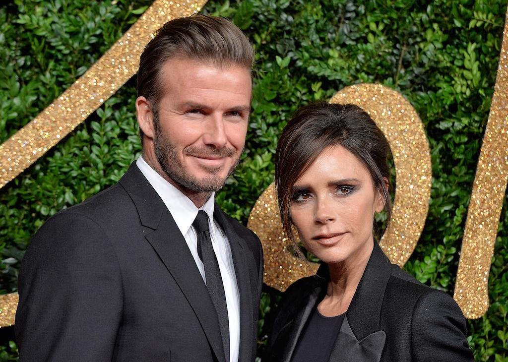 David Beckham and Victoria Beckham pose at an event