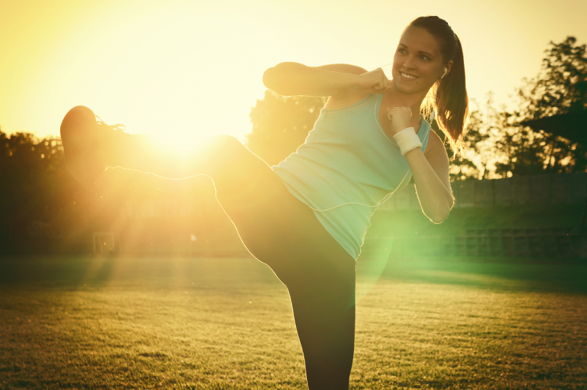 woman working out in sunset