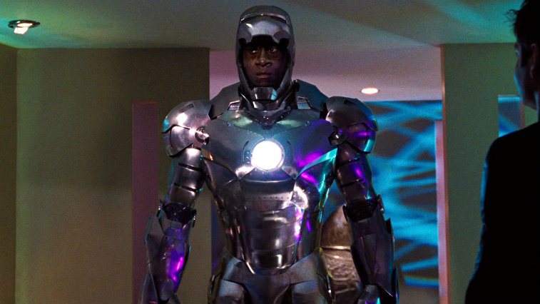 Don Cheadle in a metal suit of armor as War Machine with a fierce expression on his face in Iron Man 2