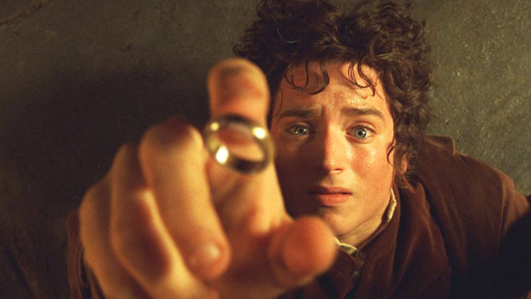 Elijah Wood reaching for a ring in The Lord of the Rings: The Fellowship of the Ring