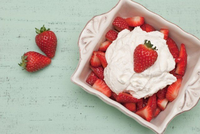 ornate bowl filled with strawberries and whipped cream