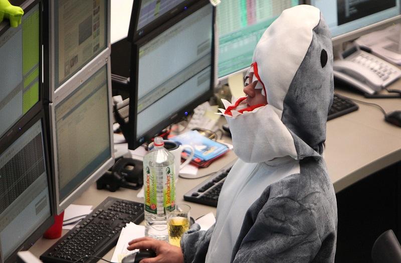A broker wears a shark costum