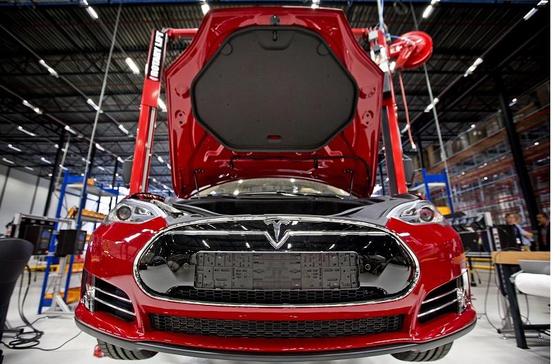 open hood of red European-spec Tesla Model S