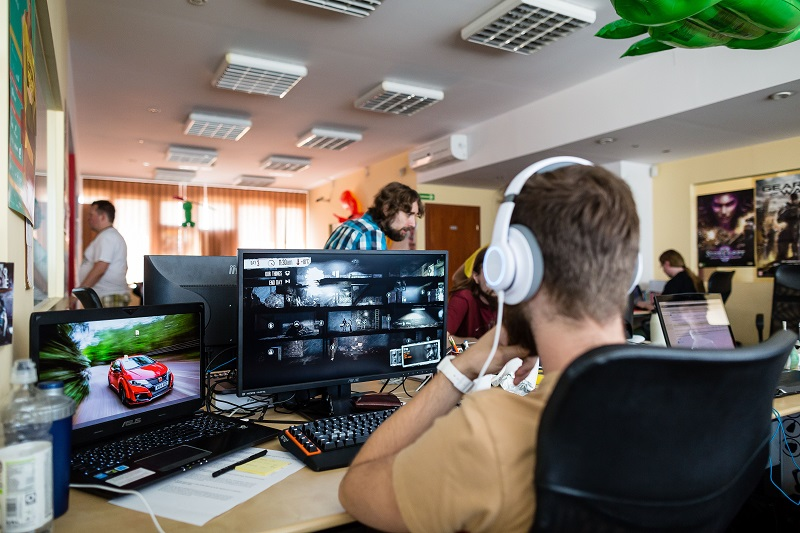 A hot job: workers producing video games are seen working in office