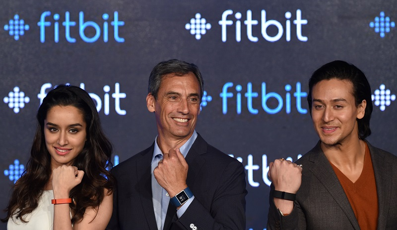 Fitbit's Chief Revenue Officer Woody Scal and Indian Bollywood actors Shraddha Kapoor (L) and Tiger Shroff