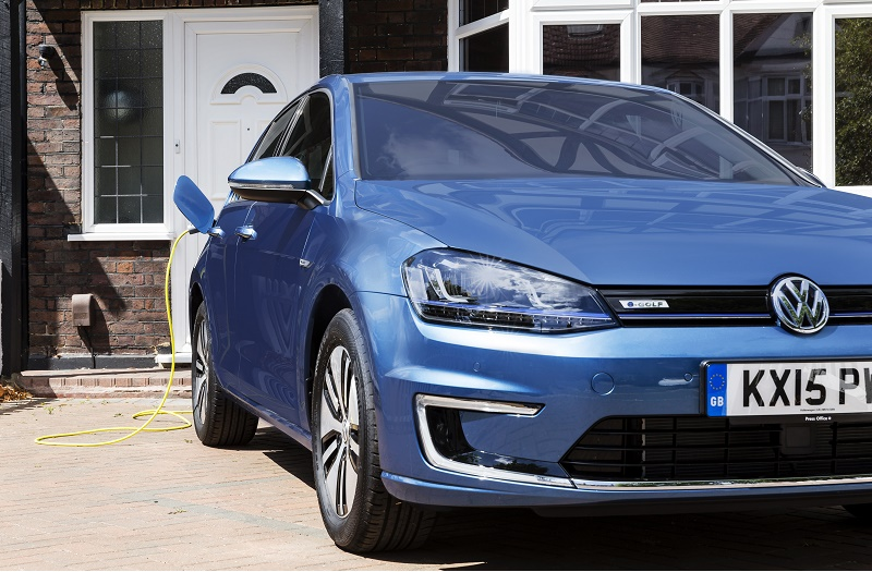 LONDON, UNITED KINGDOM - JULY 21: Go Ultra Low Volkswagen e-Golf on charge on a London driveway on July 21, 2015 in London, England. Ultra-low emission vehicles such as this can cost as little as 2p per mile to run and some electric cars and vans have a range of up to 700 miles.