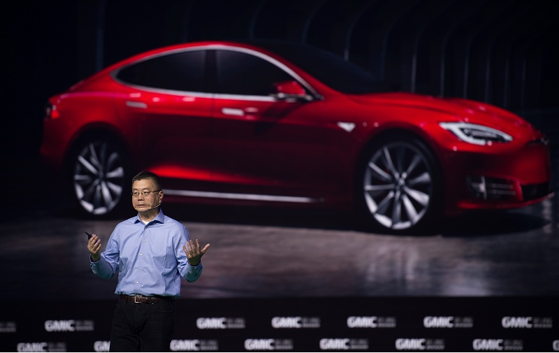 Robin Ren Global VP and Head of APAC Tesla Motors makes a speech during the Global Mobile Internet Conference (GMIC) at the National Convention Centre in Beijing on April 28, 2016. GMIC is hosting mobile executives, entrepreneurs, developers, and investors from around the world.