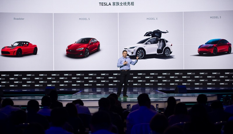 Robin Ren Global VP and Head of APAC Tesla Motors makes a speech during the Global Mobile Internet Conference (GMIC) at the National Convention Centre in Beijing on April 28, 2016. GMIC is hosting mobile executives, entrepreneurs, developers, and investors from around the world. Tesla can silence the critics.