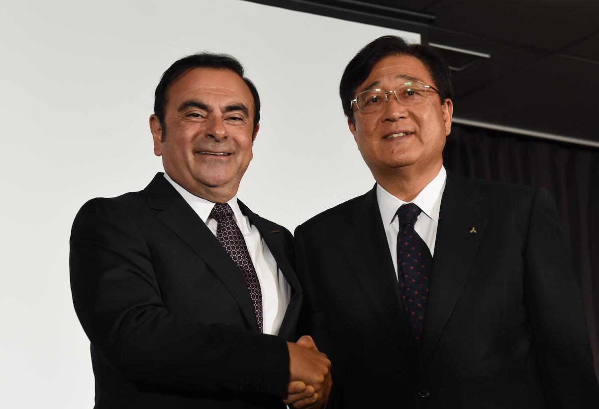 Men shaking hands, Nissan and Mitsubishi partnership