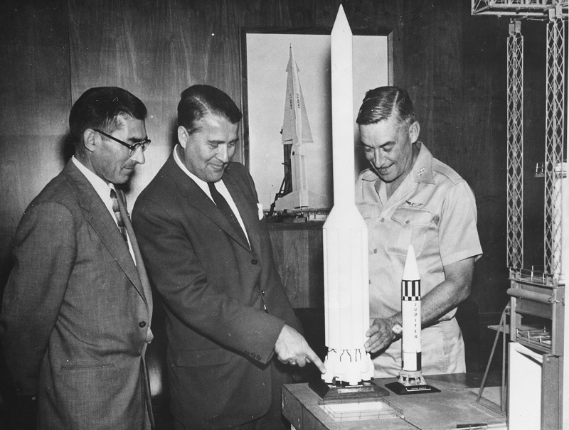 Aerospace Engineer Wernher Von Braun (centre) explaining his model of the Saturn Rocket