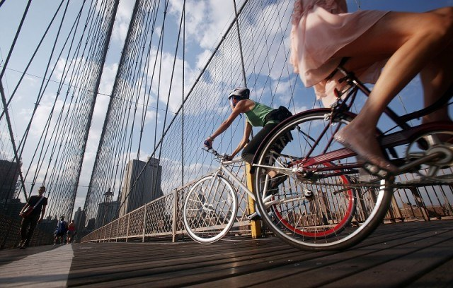 Cyclists ride across the Brooklyn Bridge during the evening commute August 25, 2009 in New York City.