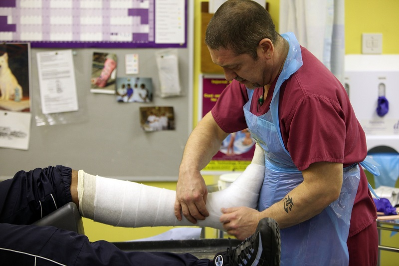 An orthopaedic practitioner casts a broken ankle