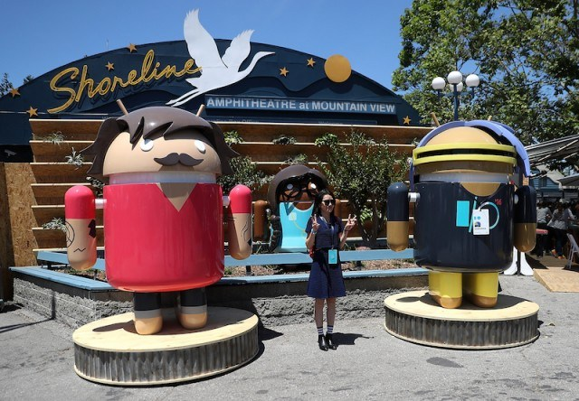 New features for Android N: An attendee poses for a photo next to Android characters during Google I/O 2016 at Shoreline Amphitheatre on May 19, 2016 in Mountain View, California. Google CEO Sundar Pichai delivered the keynote address to kick off the annual Google I/O conference that runs through May 20. (Photo by Justin Sullivan/Getty Images)